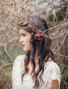 loose, braided hair + flower