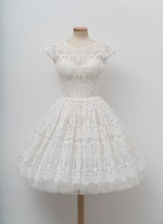 """<span class=""""s1"""">The ivory lace is sweet and delicate and has an intricate web of marzipan and foamy tulle. Best served with a playful attitude and genuine smile.</span>"""