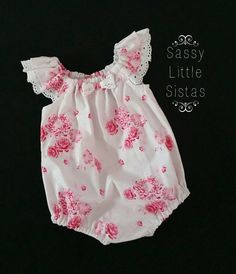 This listing a Size 0000, which is a Newborn baby size. The Little Pink Tilda Playsuit / Romper, is made from a quality 100% Cotton Designer
