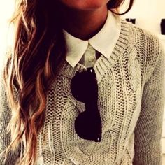 I love this look. a knit sweater with a collared shirt under.
