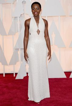 Lupita Nyong'o    Fashion Hit... Stunning Perfection Show Stopper! Wow! Covered in cream and pearls. Her skin is beautiful. She is lovely in every way.