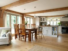 Border Oak - Open plan kitchen/dining/living room in a new build oak framed barn. Island bench with storage, wooden bench tops - Small Open Plan Kitchens, Open Plan Kitchen Dining Living, Open Plan Kitchen Diner, Open Concept Kitchen, Living Room Kitchen, New Kitchen, Kitchen White, Laminate Flooring In Kitchen, Border Oak