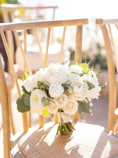 The bridal bouquet for this intimate boho beach wedding featured white roses, white peonies and eucalyptus greenery accents wrapped in beige velvet. | Bob Gail Events #bohowedding #beachwedding #microwedding Rose Bridal Bouquet, White Wedding Bouquets, White Peonies, White Roses, Different Types Of Flowers, Boho Beach Wedding, Peonies Bouquet, Groom And Groomsmen, Boutonnieres