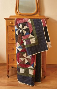 Windmills, Pinwheels, and earth tones make this easy, fat-quarter friendly, bed-size quilt pattern a hit! Come take a look at the Windmill Garden quilt by Christina McCourt!