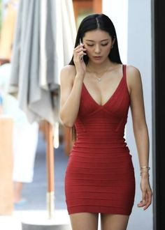 Deep v Herve Leger bandage dress
