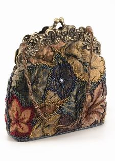 This charmng evening bag recalls the grace and elegance of a bygone Victorian era when no lady went a step outdoors without her reticule in hand. The fabulous fabric is patterned with the heavy tapestry and delicate beading that was so vastly popular and is now the rage on the runways. Paired with the delicate scrollwork frame this delightful evening bag is perfect for every occasion, from dinner to dancing. A wonderful gift that will charm women of every age.jj