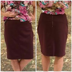 "Dark purple thick stretch skirt  size 12  NWOT Dark purple thick stretch skirt  size 12  NWOT need worn, 3 1/2"" wide waist band, front center wide seam, bold silver back center zipper,  35"" waist, 22"" length,  5 1/2"" slit front back center hem.  Bundle with matching tops in this closet! Skirts"