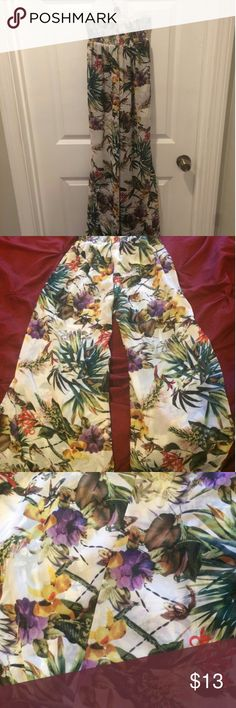 Floral/tropical wide leg flare pants Never been worn. Very unique wide leg flare pants with beautiful, brightly colored tropical plants and birds! Fabric is super breathable (100% polyester) and the waistband is stretchy and can be worn high-waisted. Pants Wide Leg