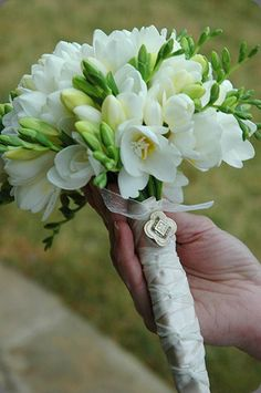 Wonderfully fragrant #bouquet of white freesia with brooch by Branching Out Events.