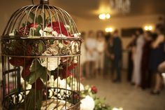 Wedding flowers bride red cage