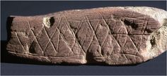 This engraved ocher plaque is the earliest known art work, found in Blombos Cave in South Africa in 1991. (Photo courtesy of Smithsonian Institution website)]
