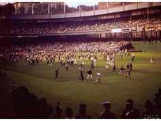 Color shot after Giants final home game in NY. Players run for it since Polo Grounds' clubhouse was in CF. 9/29/57