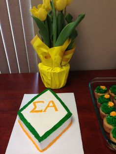 Cute Sigma Alpha cake and cupcakes at the NSB Winter Board meeting