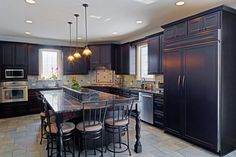 large traditional kosher kitchen with dark cabinets and dark countertops in - What Is A Kosher Kitchen