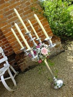 Vintage candelabra with beautiful pink and white flowers