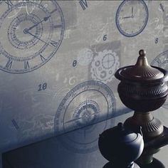 #Inspired by the art of time, Vintage Timeless Wallpaper in Silver with royal blue clock print.