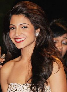 She has been maintaining her long hairs keeping it casually open often. Definitely, her long wavy hairs make her look more vibrant and you can follow it for Bollywood haircut for long hair.