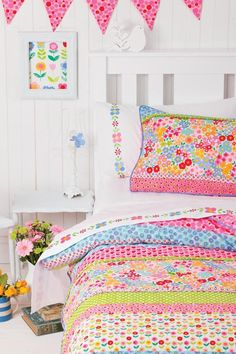 Cute children's bedroom, plain but busy. It's like a White canvas with splashes of colour!