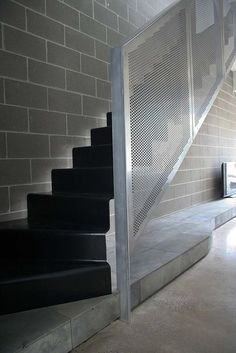 Floating steel treads with perforated metal balustrade.