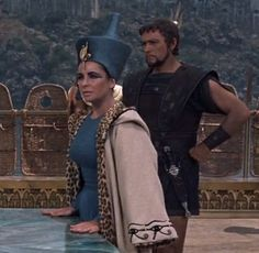 Marcus A. is fighting and in this caption Cleopatra is worried about the well-being of his lover http://mariaefmilliner.com/cleopatra-a-review-of-the-35-dresses-she-wears-on-the-movie/