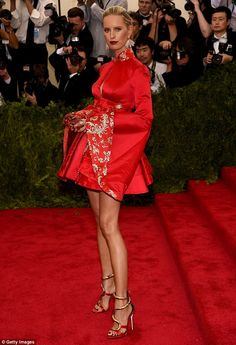 Sticking with the theme: The dress design paid tribute to China's rich cultural history co...
