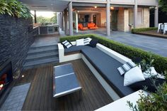 A hedge as a back to an outdoor bench. Nice. Contemporary Patio by Dean Herald-Rolling Stone Landscapes