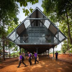 Built in the wake of an earthquake, this secondary school in Thailand by Vin Varavarn Architects has a roof-like shape and is raised on metal stilts