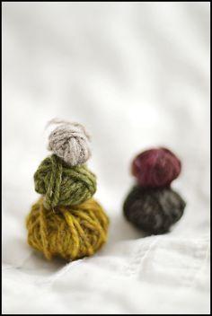 Wool snowmen. Green, grey, mustard, taupe, burgundy.
