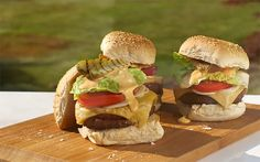 "Give your burgers some class this summer by following Heston's ""ultimate"" cheeseburger recipe. Add gherkins, juicy vine tomatoes and slices of creamy cheddar to take your barbecue burger from mediocre to marvellous"