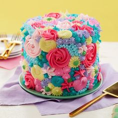 Create a literal bouquet of buttercream flowers with this Spring Floral Cake. Using very simple piping techniques, like rosettes, dots, stars and more, this cake is blossoming with bright spring colors. Cake Decorating Piping, Cake Decorating Videos, Cake Decorating Techniques, Wilton Cakes, 3d Cakes, Fondant Cakes, Giant Cupcake Cakes, Book Cakes, Cup Cakes