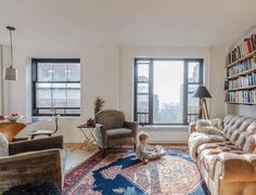 How a Clever Renovation Turned a One-Bedroom Co-op Into a Home for 4: The southern exposure and great views are maximized by the large windows. The co-op was originally built in the 1940s as housing for the workers in the Brooklyn Navy Yard. The furniture is from Casey's fourth-generation family business, Penn Furniture, located in Scranton, Pennsylvania.