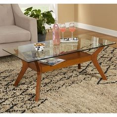 Update your living space with the Fontana coffee table. Constructed of sturdy rubberwood with a tempered glass top and a shelf for accessories, books or collectibles.