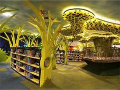 """So pretty! Obviously this would have to be done on a much smaller scale for a play/bonus room but it gives me some great ideas for a jumping off point. World's First Green Library for Kids """"My Tree House"""" Opens its Doors School Library Design, Kids Library, Elementary Library, Library Ideas, Green Library, Beautiful Library, Hidden Rooms, Home Libraries, Library Displays"""