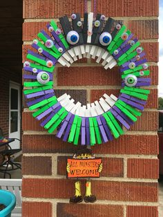 Took a twist on our American Flag clothes pin wreath to make this Monster Halloween wreath! My son figured out the perfect solution to the teeth & we love it!!
