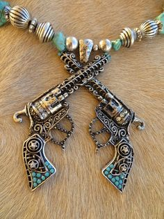 Cowgirl Bling PISTOLS GUNS PENDANT Turquoise Rhinestone Western necklace set   our prices are WAY BELOW RETAIL! all JEWELRY SHIPS FREE! www.baharanchwesternwear.com baha ranch western wear ebay seller id soloedition