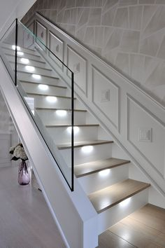 An ultra-modern staircase in light oak with LED lights installed under the steps, subtly illuminate the stairs. An ultra-modern staircase in light oak with LED lights installed under . beleuchtung beleuchtungkro moderne Beleuchtung An ultra-moder Glass Stairs Design, Home Stairs Design, Railing Design, Interior Stairs, House Design, Glass Stair Railing, Stairs Light Design, Stairs With Glass Panels, Glass Bannister