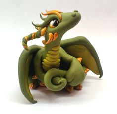 Green and Gold Dragon by Tinebell.deviantart.com on @deviantART