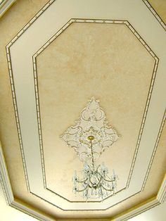 elegant two tone tray ceiling with mitered frame inset and medallion for bedroom or dining