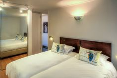 Clifton Rocks is a luxury self-catering holiday apartment in Clifton with 3 bedrooms. Cape Town Holidays, Open Plan Bathrooms, Living Area, Living Spaces, 2 Twin Beds, Shared Rooms, Holiday Apartments, Open Plan Living, Double Beds