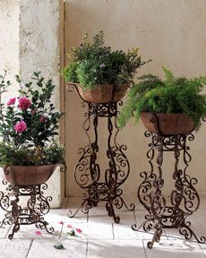 MICRO TREND // 12 Wrought Iron Products That Add Old-World Style To Your Home. Plant Stand: Soft scrolling details embellish this trio of planters which creates a stunning focal point for any interior or exterior entryway or patio area. Decor, Iron Planters, Brick Exterior House, Iron Plant Stand, Wrought Iron Plant Stands, Iron Decor, Tuscan Decorating, Plant Stand, Iron Plant