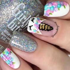 Floral nails are perfect for the spring and this design is easier than it looks. Click above for 39 more easy spring nail art.