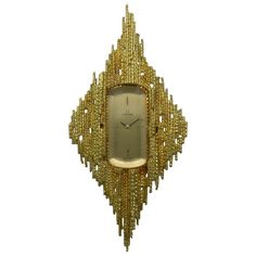 Grima Designed Omega Lady's Yellow Gold Pendant Watch circa 1970s   From a unique collection of vintage drop necklaces at https://www.1stdibs.com/jewelry/necklaces/drop-necklaces/