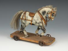 Image result for vintage wooden riding horses with metal wheels