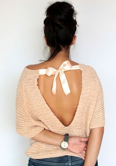 You know, I bet you could make this with an old woven sweater. Maybe cut the back out, finish the edges with embroidery thread and then add a cute bow on the top. At least then you could control how low it dips in the back (bra hiding)!!! Either way LOVING it