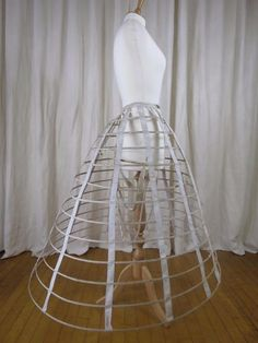 This is a super rare 1861 crinoline-cage from Thomson Frères, Paris. It is the latest and most rare and unique addition of the Dutch HiLiCoN collection. It is the missing link between Milliet and Thomson. Amazing museum object. Completely hand sewn. I cannot stop looking at it. I bought this French hoop in England. The Ebay description is wrong, by the way.
