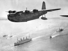 "Sunderland's flying boat escorting the ""Empress of Australia"" sailing on the English Channel with the King and Queen on board bound for Canada."