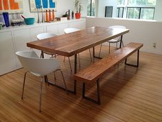 Modern dining table with square steel base