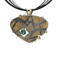 Jenny Reeves  Cobblestone pendant with blue tourmaline Recycled sterling silver and 18K gold with blue tourmaline, yellow sapphire, and diamonds sterling silver multi-cable. Oxidized,  1 3/4 inches wide.