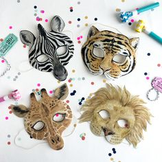 Children's Animal Masks / set of 4 / original watercolor paintings printed onto quality cotton canvas / from the Circus Theme collection by Wonderful Collective. An absolute must for a child's birthday party.