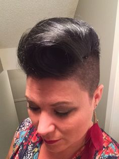 Mohawk French roll. Black. Buzzed sides